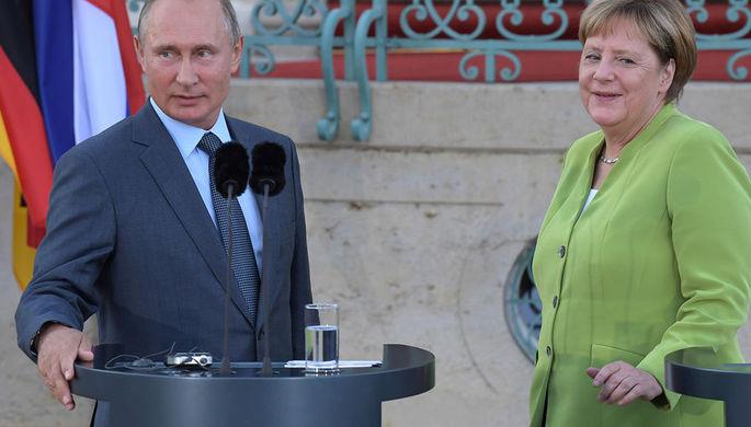 Путин иМеркель обсудили закрепление особого статуса Донбасса вукраинском законодательстве