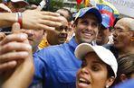 Лидер венесуэльской оппозиции Энрике Каприлес оспорил в четверг в верховном суде страны официальные...