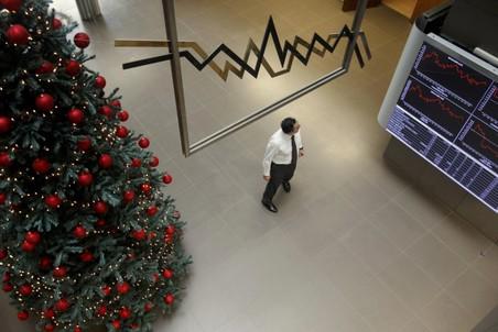 Долговой кризис портит праздничное настроение в Европе и Азии