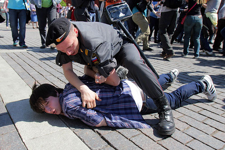 Police officer detains LGBT activist during an unsanctioned protest may 28 2011