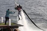 Олимпийский факел погрузили на дно Байкала и вернули на сушу с помощью ранца-водомета