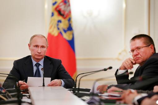 Владимир Путин и министр экономического развития РФ Алексей Улюкаев