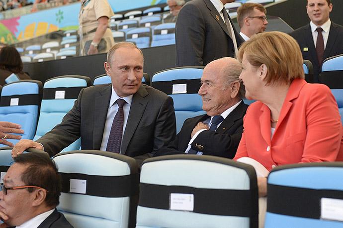Владимир Путин, Йозеф Блаттер и Ангела Меркель на ЧМ-2014 в Бразилии