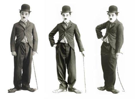 Даже если бы не было видно лица, Чарли Чаплина в образе Маленького Бродяги можно узнать по котелку, тросточке и положению ног // Фотография: iledebeaute.ru