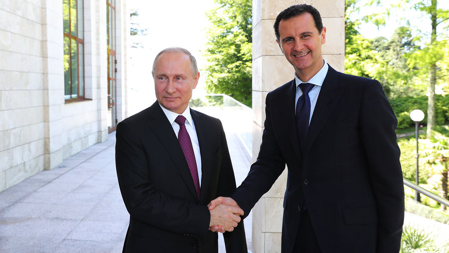 Президент России Владимир Путин и президент Сирийской арабской республики Башар Асад во время встречи в Сочи, 17 мая 2018 года