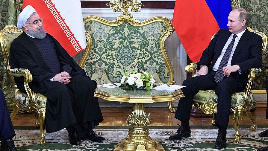 Президент Ирана Хасан Рухани и Владимир Путин во время встречи в Кремле