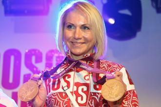 Ольга Забелинская в Лондоне с наградами Олимпиады