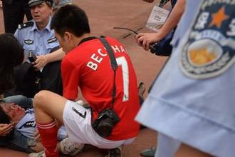 Семь человек пострадали в давке во время визита Бекхэма в Шанхай