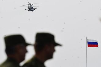 Многоцелевой всепогодный вертолет ВВС РФ Ка-52 осуществляет огневую поддержку во время стратегических командно-штабных учений «Восток-2014»