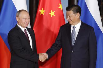 3 сентября 2017. Президент РФ Владимир Путин и председатель КНР Си Цзиньпин во время встречи на полях саммита БРИКС в Сямэне