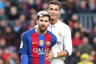 Футболисты мадридского «Реала» и «Барселоны» Криштиану Роналду и Лионель Месси