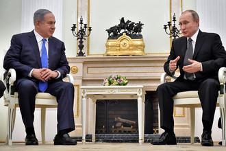 Президент России Владимир Путин (справа) и премьер-министр Израиля Биньямин Нетаньяху во время встречи в Кремле 21 апреля 2016 года