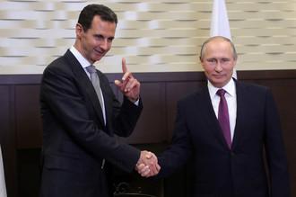 Президент Сирии Башар Асад и президент России Владимир Путин и во время встречи в Сочи, 21 ноября 2017 года