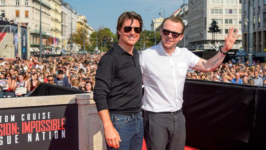 Актеры Том Круз и Саймон Пегг на премьере фильма «Миссия невыполнима: Племя изгоев» в Вене, 2015 год