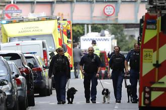 Полиция на улице Лондона после взрыва в метро, 15 сентября 2017 года