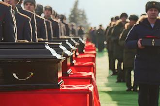 Похороны жертв крушения самолета Ту-154 Минобороны России, который направлялся в Сирию и упал после вылета из Сочи, на военном мемориальном кладбище в Подмосковье, январь 2017 года