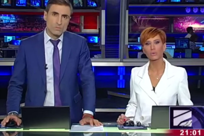 Диана Джоджуа и Михаил Сесиашвили во время прямого эфира телеканала «Рустави 2», 20 августа 2019 года (кадр из видео)