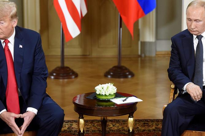 Президент США Дональд Трамп и президент России Владимир Путин во время встречи в Хельсинки, 16 июля 2018 года