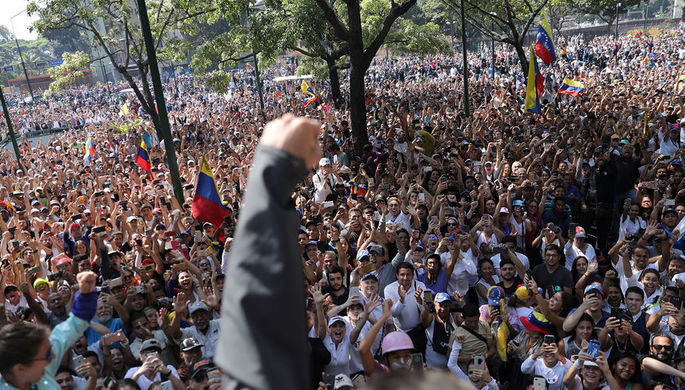 Сторонники венесуэльской оппозиции во время демонстрации в Каракасе, 30 апреля 2019 года