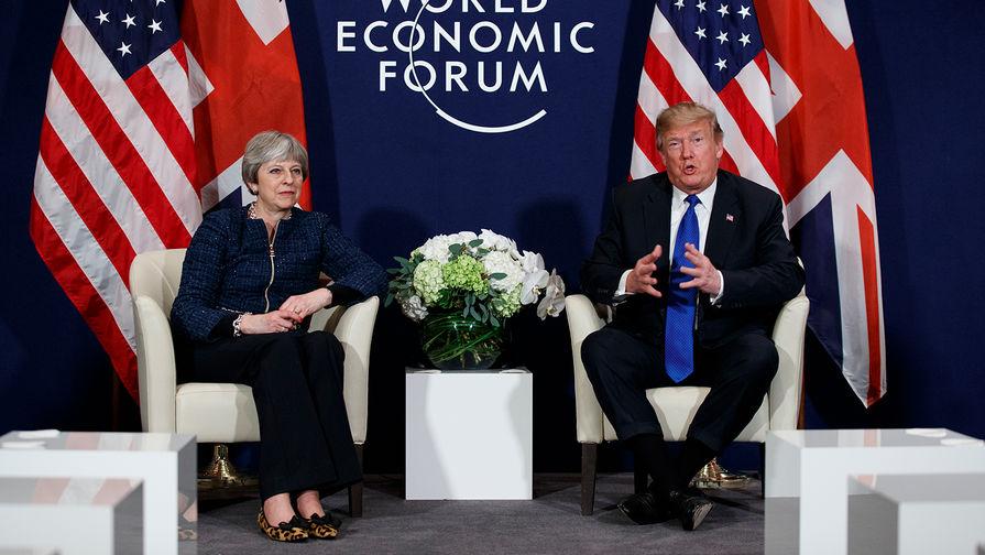 Премьер-министр Великобритании Тереза Мей и президент США Дональд Трамп на Всемирном экономическом...