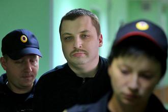Михаил Косенко, обвиняемый в участии в массовых беспорядках на Болотной площади 6 мая 2012 года