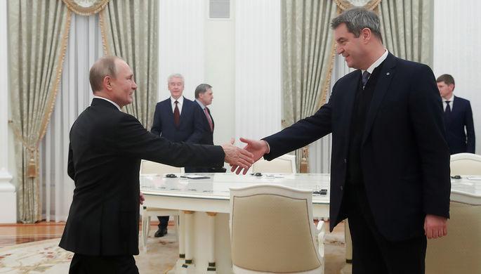 Президент России Владимир Путин и премьер-министр федеральной земли Бавария Маркус Зедер во время встречи, 29 января 2020 года