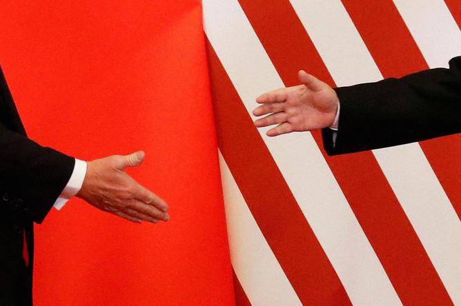 Президент США Дональд Трамп и председатель КНР Си Цзиньпин во время встречи в Пекине, 2017 год