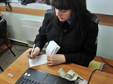 «Газета.Ru» разбиралась, почему оплаченные штрафы ГИБДД еще долгое время числятся за водителями как непогашенные