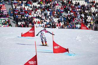 Вик Уайлд (Россия) в финале параллельного гигантского слалома на соревнованиях по сноуборду среди мужчин