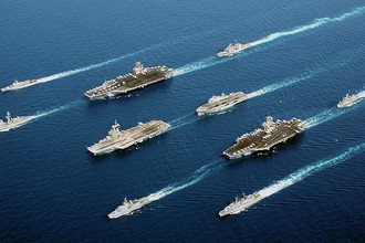 Naval vessels from five nations sail in parade formation for a rare photographic opportunity at sea. From top row left to right: the Italian Navy (Marina Militare) ship Maestrale Class Frigate MM MAESTRALE (F 570), French Navy Tourville Class Destroyer DE GRASSE (D 612), Nimitz Class Aircraft Carrier USS JOHN C. STENNIS (CVN 74), US Navy (USN) Ticonderoga Class Cruisers USS PORT ROYAL (CG 73), French Navy Charles de Gaulle Class Aircraft Carrier CHARLES DE GAULLE (R 91), Royal Navy Helicopter Carrier, Her MajestyХs Ship (HMS) OCEAN (L 12), French La Fayette Class Frigate SURCOUF (F 711), Aircraft Carrier USS JOHN F. KENNEDY (CV 67), Netherlands Navy Karel Doorman Class Frigate Her MajestyХs Netherlands Ship (Harer Majesteits) (HNLMS) VAN AMSTEL (F 831), Italian Navy De La Penne (ex-Animoso) Class Destroyer, MM LUIGI DURAND DE LA PENNE (ex Animoso) (D 560). The coalition forces are deployed in support of Operation ENDURING FREEDOM.