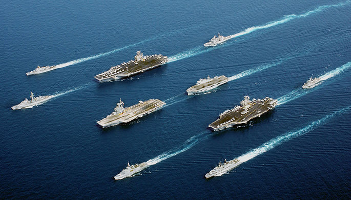 Naval vessels from five nations sail in parade formation for a rare photographic opportunity at sea...