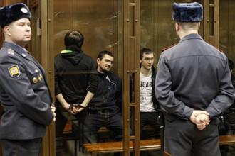 Аслан Черкесов (в центре) на оглашении приговора