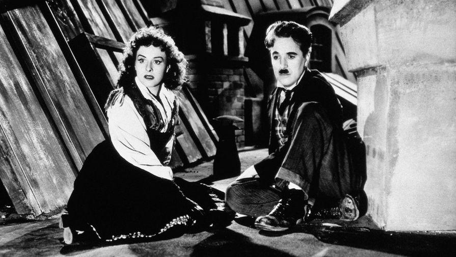 Чарли Чаплин и Полетт Годдар в фильме «Великий диктатор» (1940)