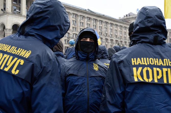 Участники акции национального корпуса (организация запрещена в РФ) на площади Свободы в Киеве, 16 марта 2019 года