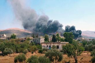 Дым над одним из районов Идлиба, Сирия, 4 сентября 2018 года