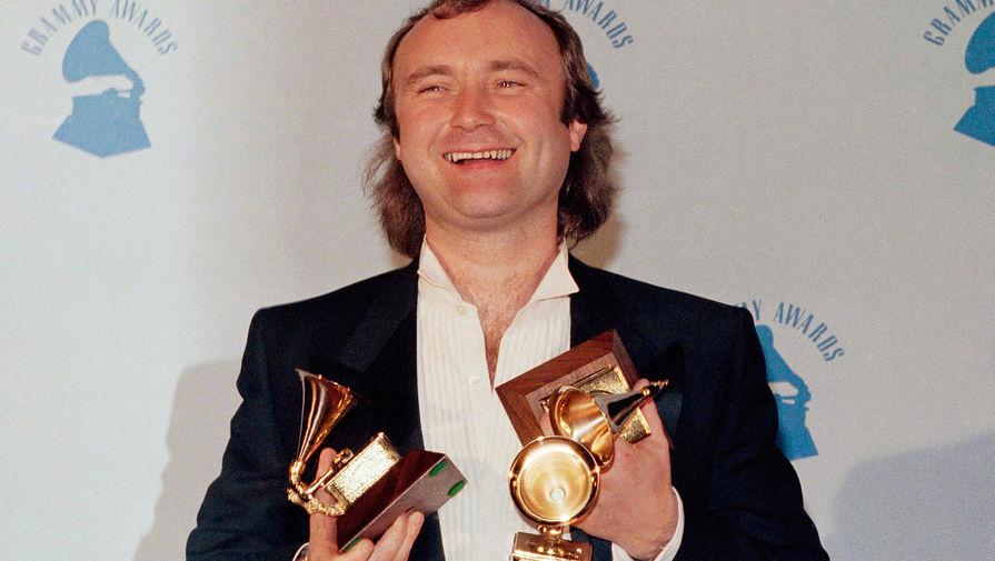 За 20 лет существования Genesis выпустила 12 альбомов и завоевала популярность во всем мире. Группа продала более 150 млн копий альбомов (из них около 22 млн — в США). Кроме ударных и вокала Фил Коллинз занимался написанием песен, индивидуальным творчеством и работал с джазовым инструментальным коллективом Brand X. На фото: Коллинз на церемонии вручения «Грэмми» в Лос-Анджелесе в 1986 году, где он получил три награды — за лучший альбом, как лучший поп-вокалист и продюсер года