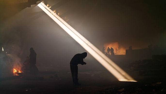 Мигранты на заброшенном складе в Белграде, Сербия, январь 2017 года