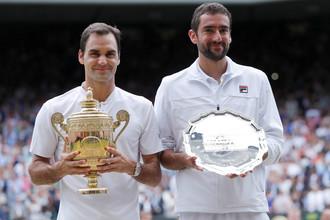 Победитель Уимблдона-2017 Роджер Федерер и проигравший ему Марин Чилич