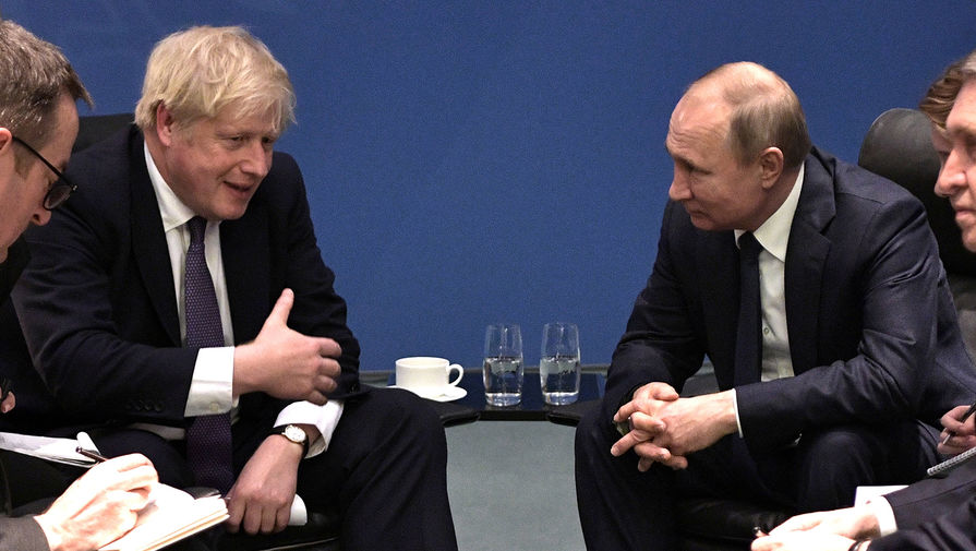 Британский премьер Борис Джонсон и президент России Владимир Путин во время встречи, 19 января 2020 года
