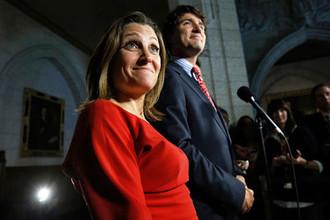 Лидер Либеральной партии Канады Джастин Трюдо и кандидат на довыборах в Палату общин Христя Фриланд во время пресс-конференции в Оттаве, 2013 год