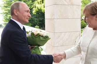 18 мая 2018 года. Президент России Владимир Путин и федеральный канцлер ФРГ Ангела Меркель во время встречи в Сочи