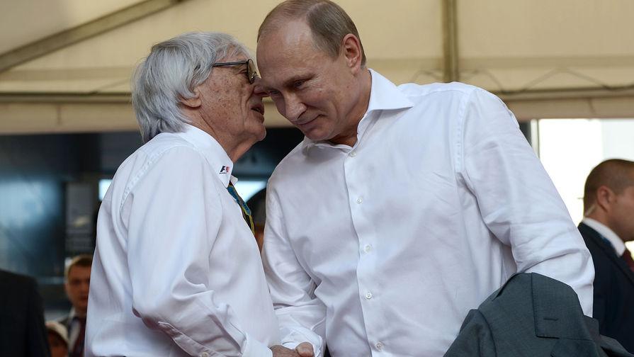 Президент России Владимир Путин и генеральный промоутер «Формулы-1» Берни Экклстоун во время российского этапа гонки чемпионата мира по кольцевым автогонкам в классе «Формула-1» в Сочи, 2014 год