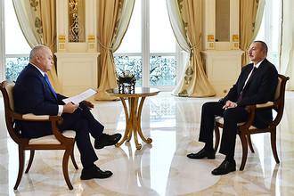 Телеведущий Дмитрий Киселев и президент Азербайджана Ильхам Алиев