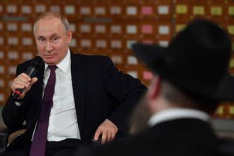 Президент РФ Владимир Путин во время встречи с представителями общественности Республики Крым и Севастополя, 18 марта 2019 года