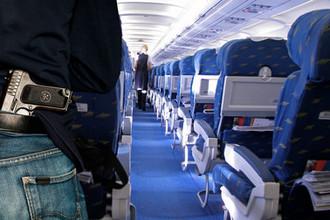 На борт с пистолетом: как в Шереметьево не уследили за пассажиром