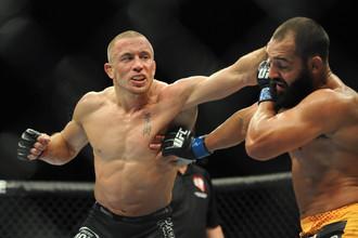 Джордж Сент-Пьер защитил свой титул чемпиона UFC в полусреднем весе, победив Джони Хендрикса раздельным решением судей