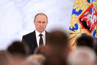 Президент России Владимир Путин во время выступления с ежегодным посланием к Федеральному собранию РФ в Кремле