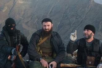 Лидер радикальной группировки «Имарат Кавказ» Магомед Сулейманов (в центре)