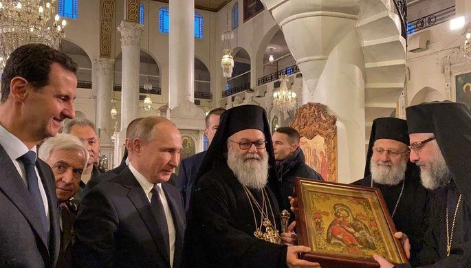 Президент России Владимир Путин и президент Сирии Башар Асад в соборе Пресвятой Богородицы в Дамаске, 7 января 2020 года