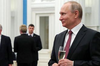 Президент России Владимир Путин во время торжественного приема после церемонии вручения медалей «Герой Труда Российской Федерации» в Кремле, 29 апреля 2019 года